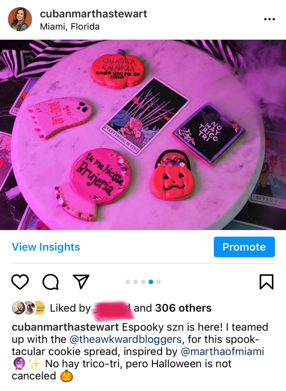 Iced sugar cookies in the shape of a pumpkin, ghost, crystal ball, trick or treat pumpkin, and message board, surrounded by smoke and tarot cards